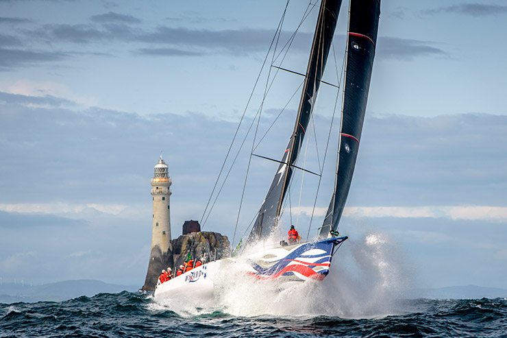 Wizard - 2019 Rolex Fastnet Race winner launches off a wave shortly after passing he Fastnet Rock and heading to the finish